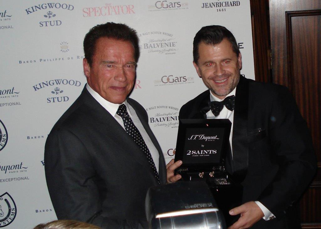 Arnold Schwarzenegger accepting his award for Celebrity Cigar Smoker of the Year 2014